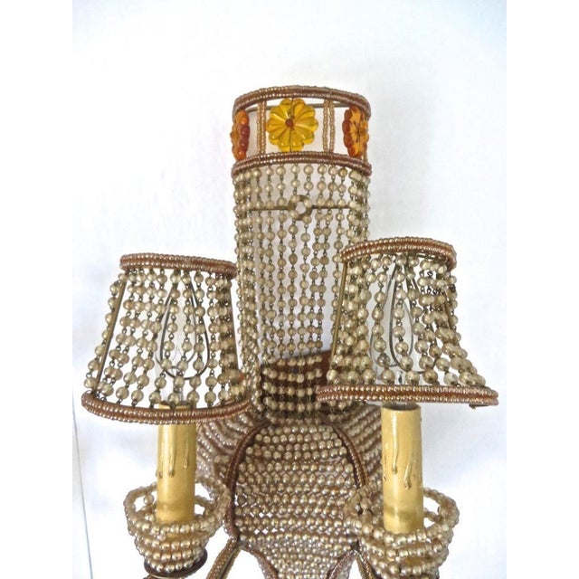 """A stunning pair of Hollyywood Regency """"Maison Bagues"""" style Large Sconces. 2 lights each, all the wire work beaded. Very..."""