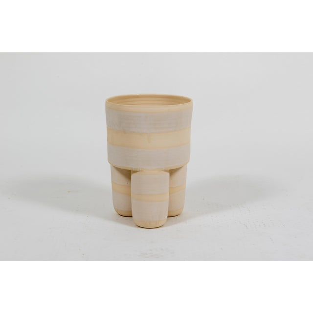 This Ceramic piece is handcrafted in New York and can also be ordered as a garden stool.
