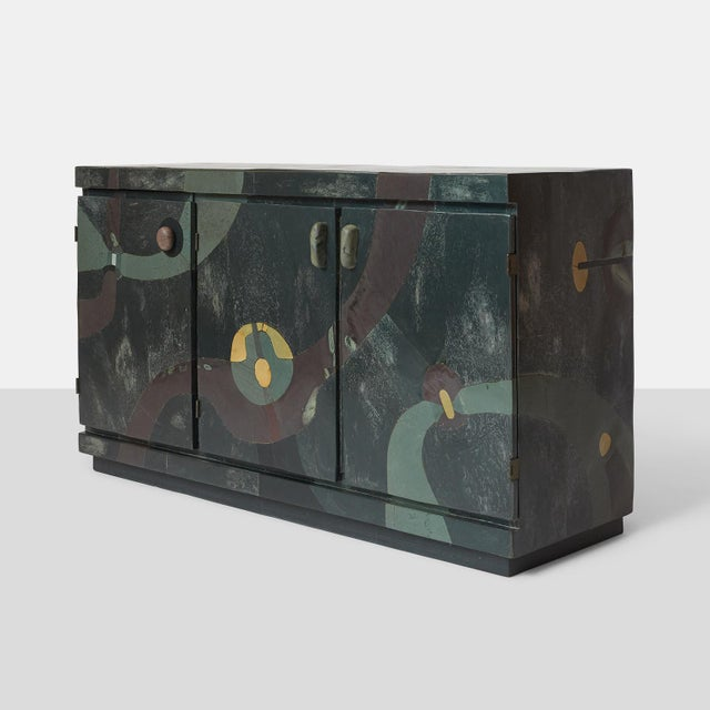 A unique credenza by Pierre-Elie Gardette with three doors and covered in slate marquetry to create an abstract pattern....