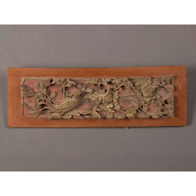 A carved, painted and gilded rectangular plaque from Kuang Hsu period China c.1875. This unique example of Chinese...