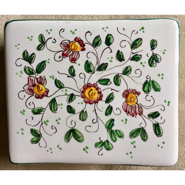 This charming vintage Italian faience ceramic box is hand-painted with lovely pink flowers and green leaves and vines....