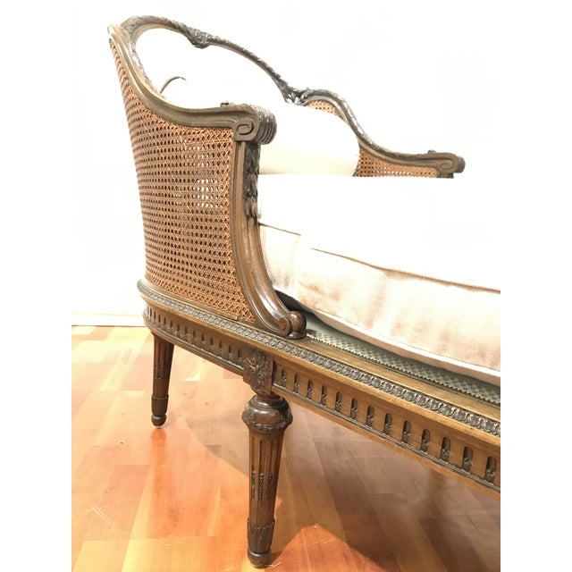 Beautifully carved European mahogany wood framed Chaise with the original blind cane and finish. This piece had some...