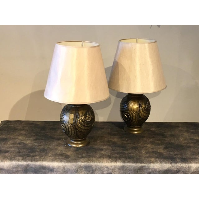 Pair of Art Deco Frederick Cooper table lamps. Nicely detailed metal bases with light grey shades. Excellent condition.