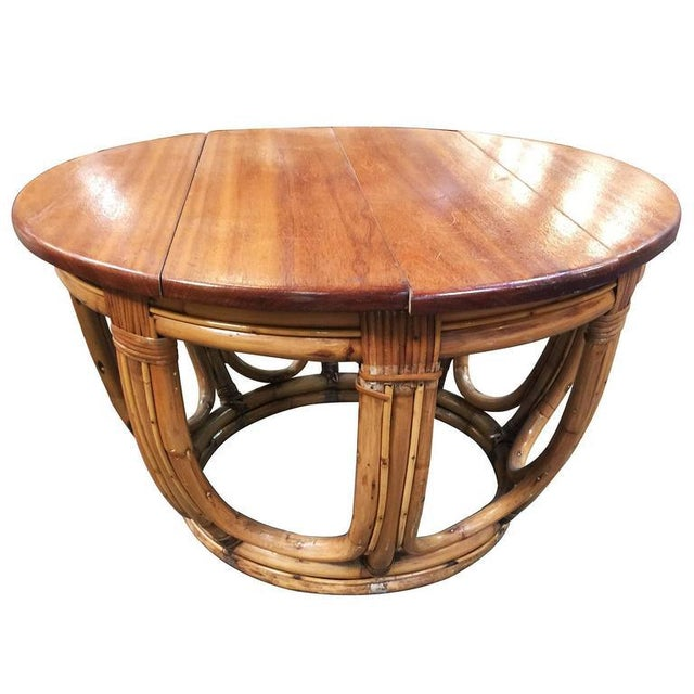 Circular rattan coffee table, circa 1940. This rare rattan table features a unique stack rattan base made with cut-out...