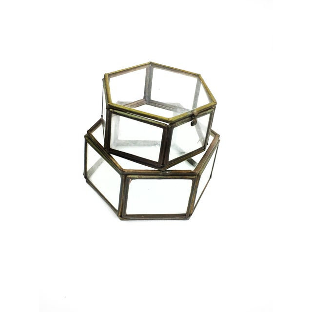 Vintage mid century set of two geometric hexagon glass and brass display cases / boxes. This beautiful set features two...