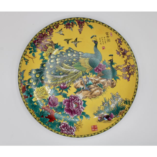 A stunning vintage ceramic yellow Asian Modern style peacock charger, circa 1960. The condition is excellent vintage, with...
