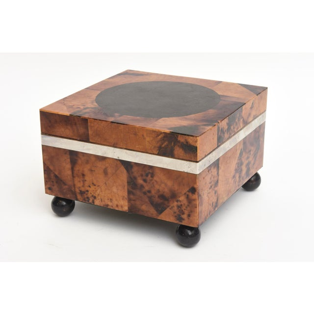 This handsome and versatile square Maitland Smith hinged box/ jewelry box is made of tessellated tortoise shell, black...