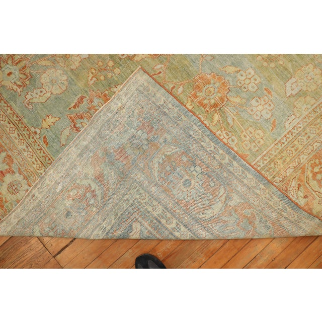 A late 19th Century Room SIze Persian Sultanabad Rug with an all-over design on a pale green field. Professionally Cleaned...