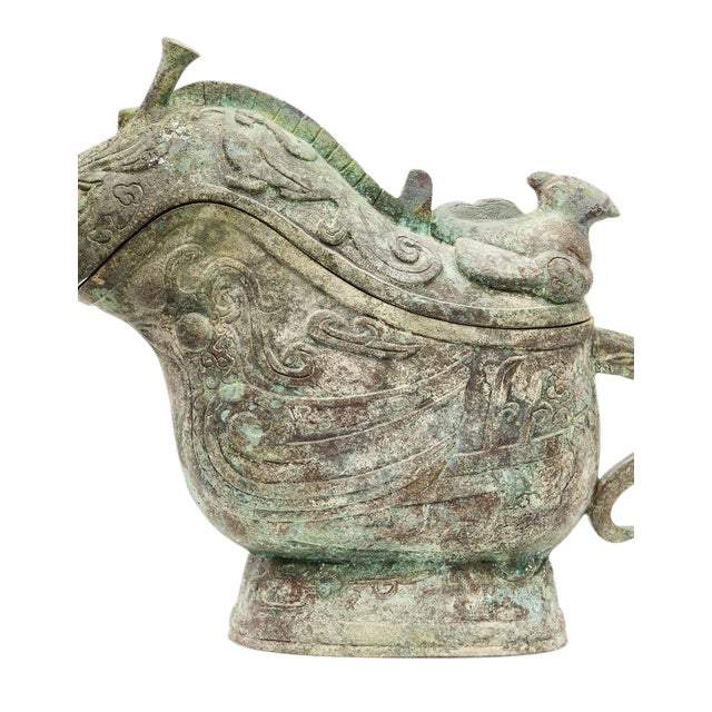 This patinated large snail box is a verdigris bronze piece with archaic Chinese motif. This creation was designed by Lucia...