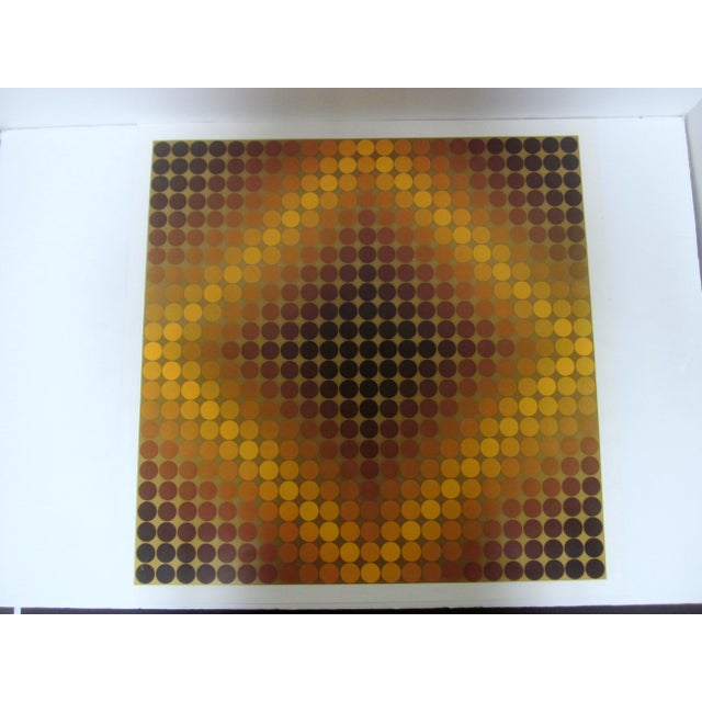 A print by Victor Vasarely 1908-1997, Hungarian/French artist. Offset Lithograph. Yellow, gold, to brown circles in square...