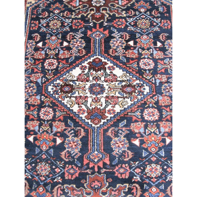 This pleasant rug from the area of Hamadan in western Persia combines a formal Persian medallion format with a more...