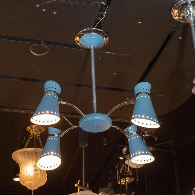 This graphic and refined Mid-Century Modern chandelier was realized in France, circa 1950. It features four hourglass...