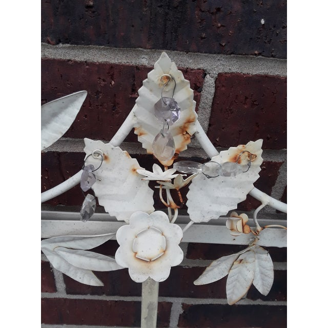 What a find! This intricate white metal tole frame for either mirrors or artwork is covered in well defined flowers, oak...