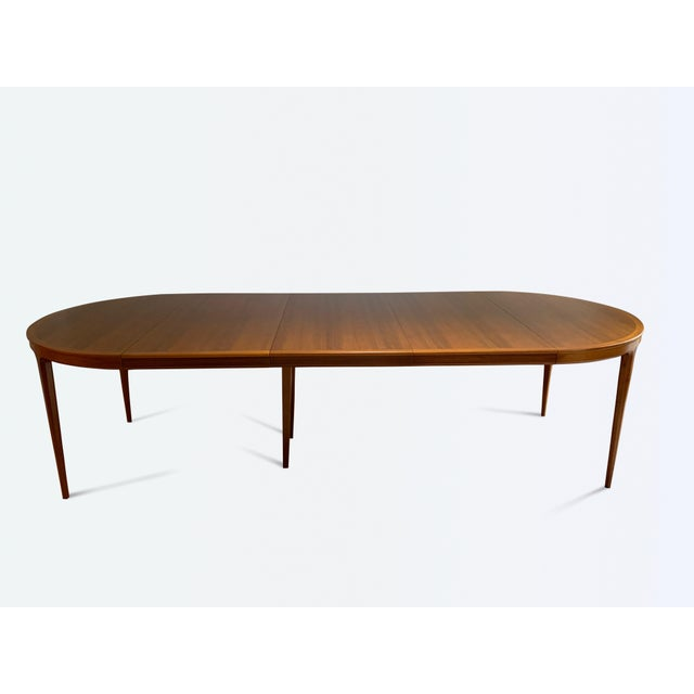 An extendable dining table designed by Bertil Fridhagen for Bodafors, Sweden. This table is made of walnut wood and a...