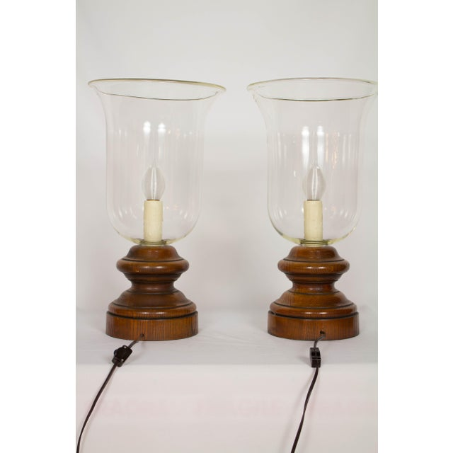 Pair of large vintage hurricane lamps. Rustic wooden bases. Cleaned and rewired with line switches and new polybeeswax...