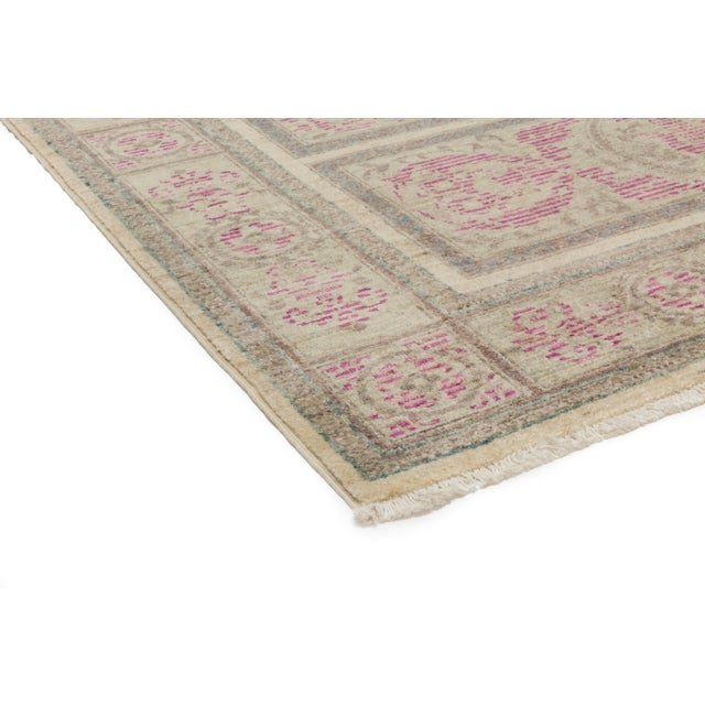 A hand knotted rug inspired by a traditional Ziegler style rug. The tradition of hand-knotting rugs has been passed from...