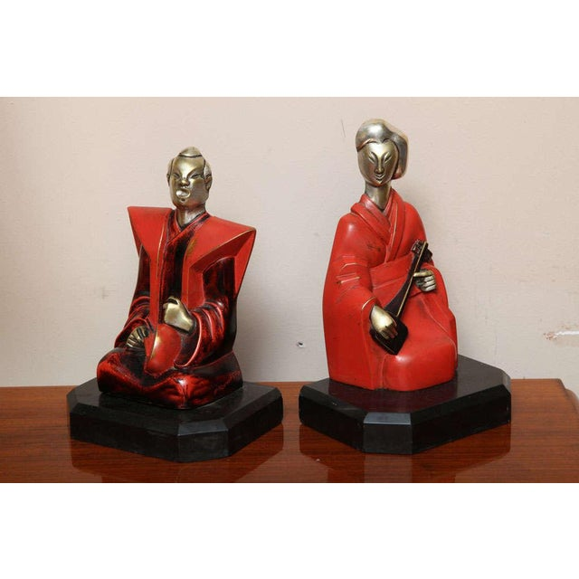 Pierre Ernest Bouret. Silvered and lacquered bronze bookends, from circa 1928, signed and numbered. French sculptor Pierre...