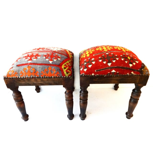 A superb pair of square wood stools that have newly been upholstered in a late-19th-century handmade tribal Caucasian...