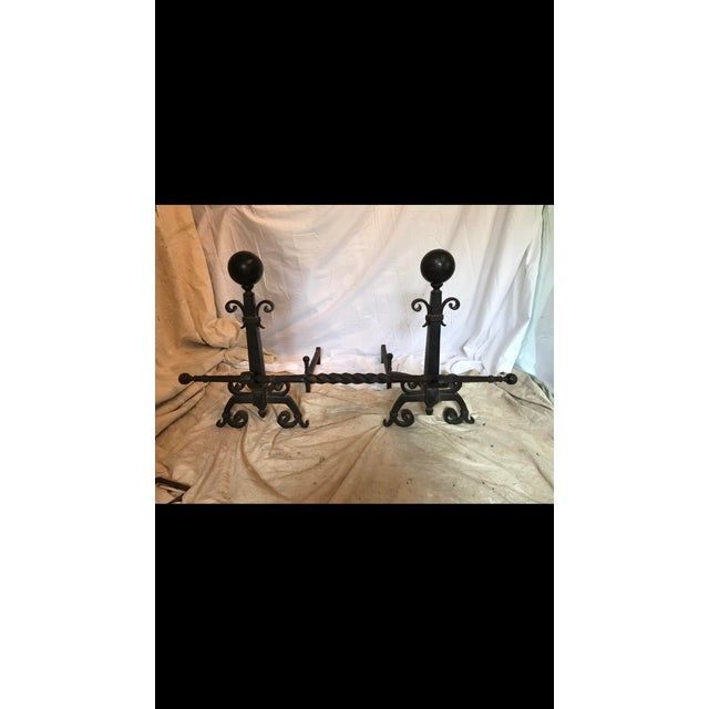 Amazing , rare medieval style wrought iron Andirons with crossbar. 3 pieces total and very heavy weight. Acquired from an...