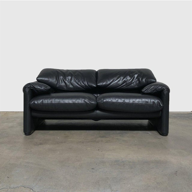 Cassina '675 Maralunga' Sofa & Ottoman by Vico Magistretti Cozy black leather two seat sofa. Comes with ottoman and...