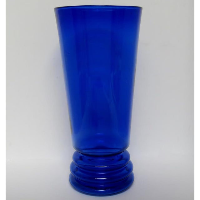 Tall blown glass flared-shape vase in rich cobalt shade and Scandinavian-style hoop accent around its base. No maker's mark.