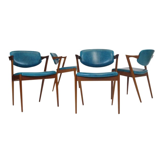 Six Kai Kristiansen model 42 teak dining chairs manufactured by V. Schou Andersen, circa 1964. The chairs features solid...