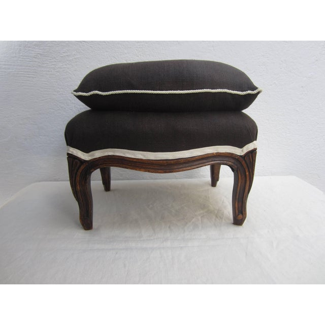 Louis XV ottoman with attached separate pillow upholstered in chocolate linen ivory trim and cording.