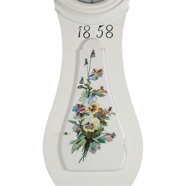 Antique Swedish Mora Clock 1858 An antique Mora Clock dated 1858 with original hand painted floral details. This clock has...