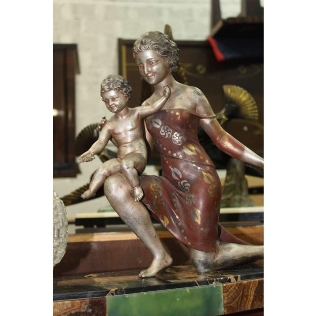 A French Art Deco Patinated Sculpture Group/ Lamp signed by U. Cipriani. Mother and Child. circa 1940s. SIZE 15.50 in.Hx22...