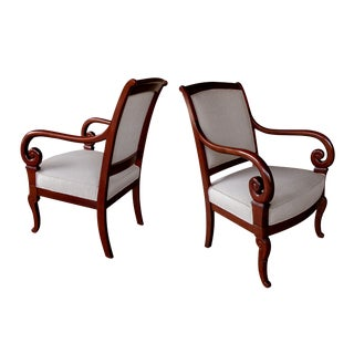 A Gracefully Proportioned Pair of French Restauration Mahogany Armchairs For Sale