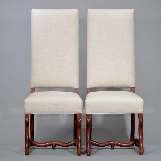 Circa 1920s set of eight classic Os de Mouton French dining chairs. Carved dark wood frames, with each chair seat and back...