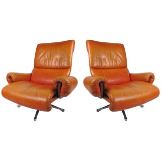 Pair of Vintage Rosewood and Leather Swivel Lounge Chairs For Sale