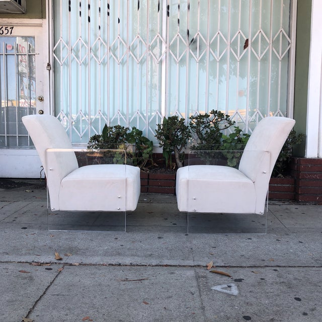 Fabulous pair of vintage lucite lounge chairs. These chairs are just stunning.