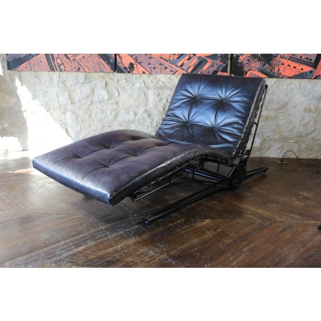 Osvaldo Borsani L-77 adjustable iron framed chaise lounge with tufted black leather cushions. Dimensions overall as pictured