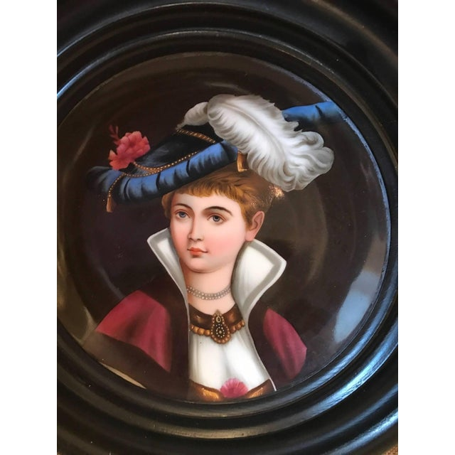 Hand-painted porcelain cabinet plates with original ebonized custom frames. Each one depicting an aristocratic woman in...