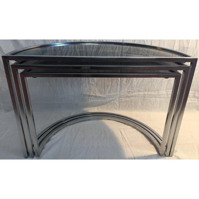 Title: Italian Chrome and Smoke Glass Nesting Tables. Period: 1970s. Description: Three nesting tables, designed and...