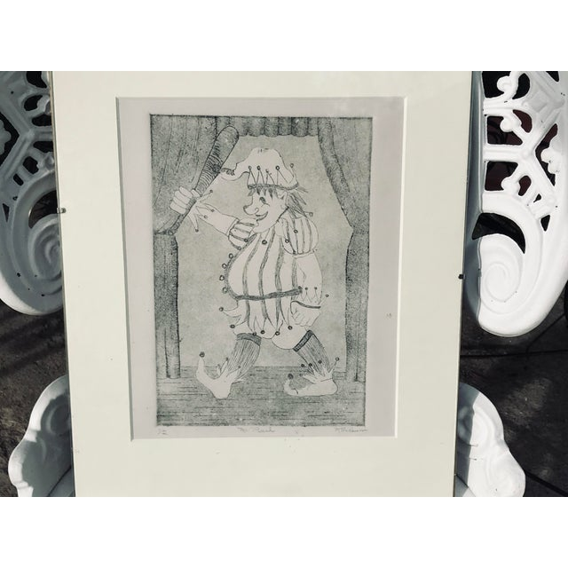 "Original etching; ""Mr. Punch"" 1/2 ; Signed M. Reusyn; matted dimension is 11""x14""; etching 7.5"" x 9.5"". Meticulously..."