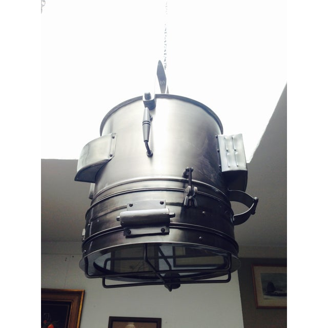 This is an absolutely stunning industrial hanging pendant in a gun metal finish. Custom made piece that is ready to go...