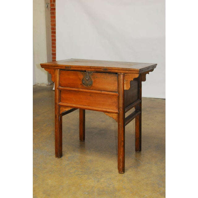 Handsome Chinese altar table coffer fronted by a single drawer with a large metal brass lock plate. Features mortise and...