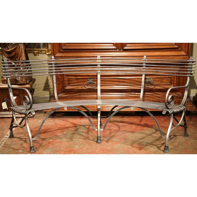 This elegant forged and curved iron bench was crafted in France and has a beautiful polished gun barrel finish. The...