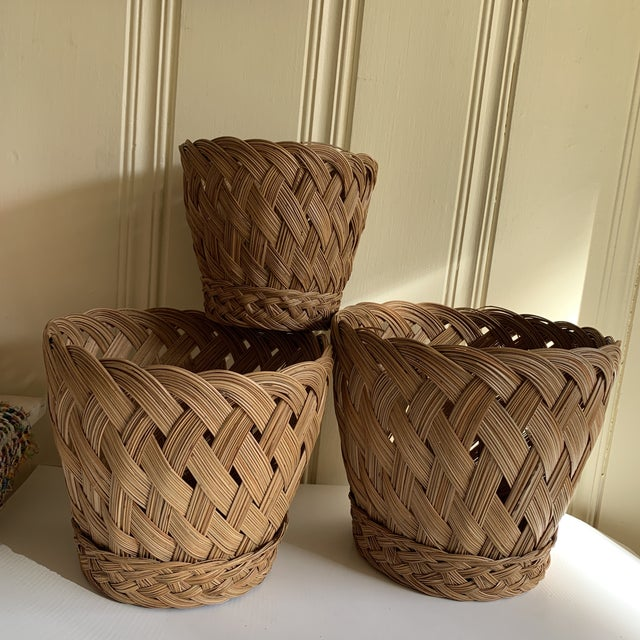 Elegant set of three woven baskets, set of three. The smallest is 7x6, mediums 9x8 and the largest is 10x9. Perfect for...