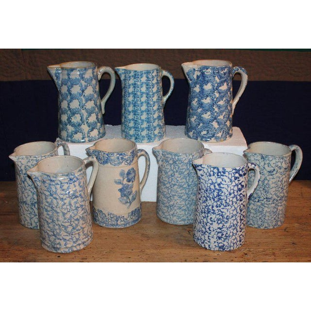 This fine collection of tall and assorted 19th century sponge ware and design sponge pottery pitchers. All in very good...