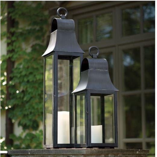 This tall, powder-coated stainless steel lantern is tailor made for your outdoor space. We've even included the drain...