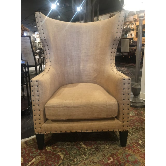 Noir Furniture's updated version of a wingback chair with burlap upholstery and nailhead accents. Noir's collections...