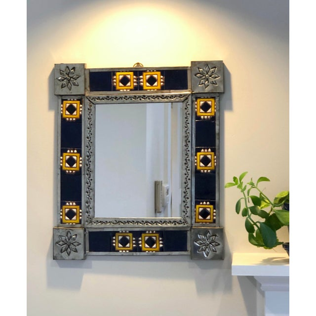 Hand made vintage mirror with original blue/gold/white, geometric tile and embossed metal details. Hook is welded onto the...