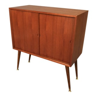 Mid-Century Curated Small Chest With Sliding Doors For Sale