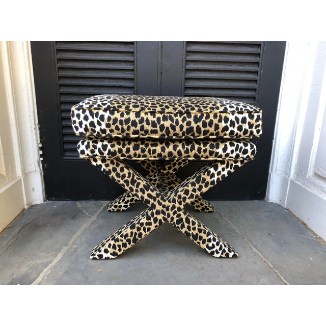 Handsome pair of mid-century modern X benches updated in new leopard ultra suede fabric. Top cushion attached. These are...