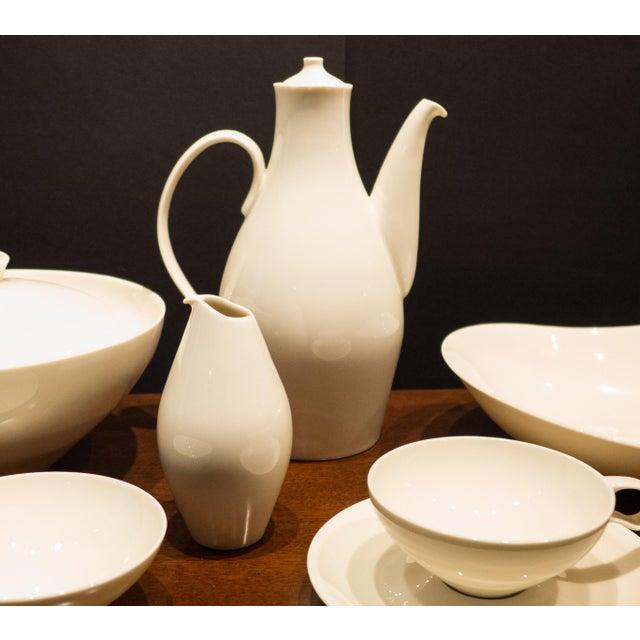 Extraordinary museum-quality Eva Zeisel porcelain Museum service by Castleton. Complete seven-piece service for ten (cups...