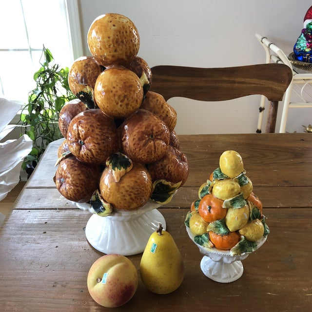 Beautiful talion fruit orange and lemon topiaries with marble fruits, perfect for the interior designer.