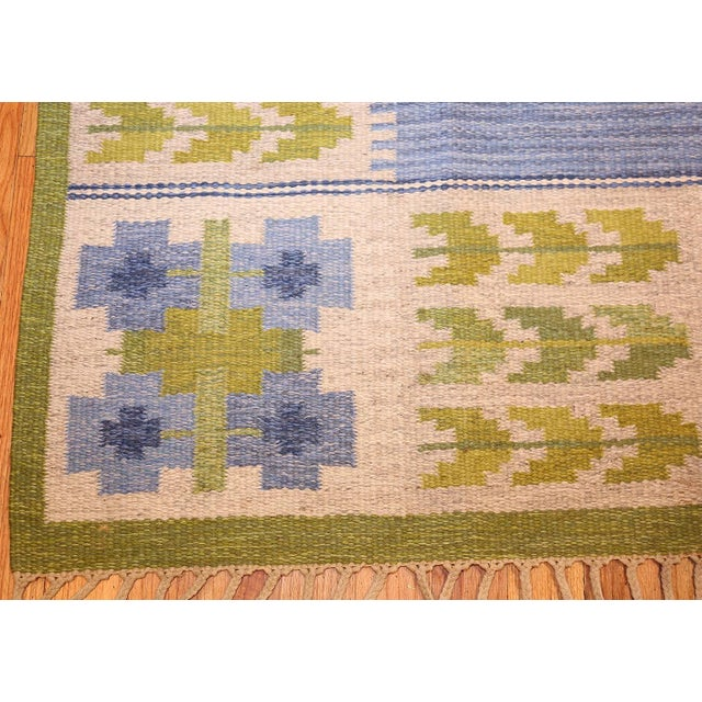 Vintage Kilim by Berit Woelfer, Sweden, mid-20th century. Simple in its color scheme and overall presentation, this...
